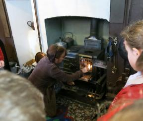 Lighting the stove in the Victorian Kitchen